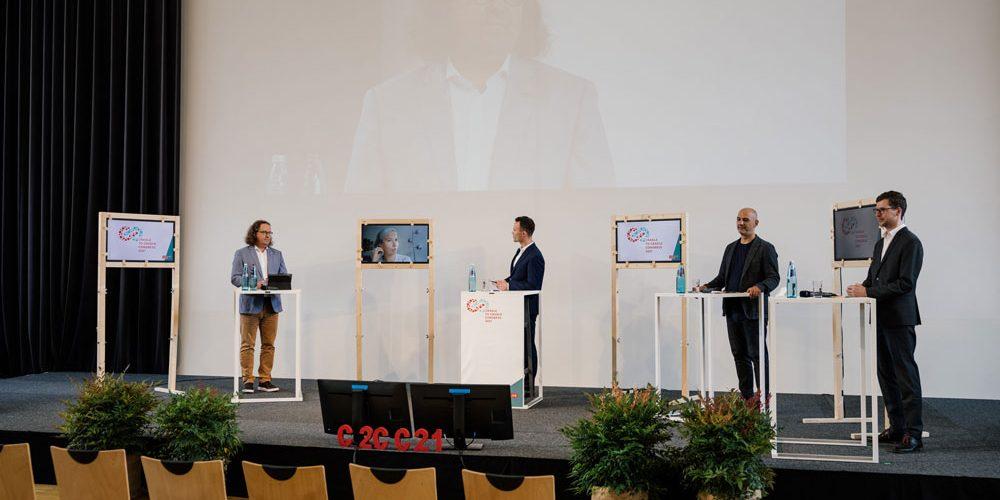 C2CC21_Freiburg08_Interaktives-Forum_Normen-und-Standards-für-zirkuläres-Bauen_Lars-Baumgürtel_Anna-Braune_Benjamin-Hein_Antonino-Vultaggio_Patrick-Bergmann-(v.l.n.r.)©Cradle-to-Cradle-NGO_Max-Arens